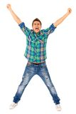 Young man with arms raised. Shouting Stock Photo