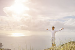 Young man with arms wide open - relax freedom success concept Royalty Free Stock Photo