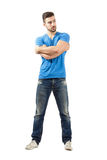 Young man with arms wrapped around himself looking away Royalty Free Stock Images