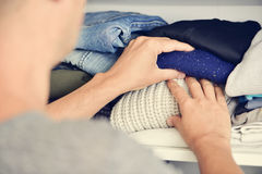 Young man arranging the closet Royalty Free Stock Photo