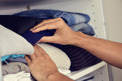 Young man arranging the closet Stock Image