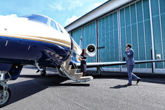 Young man arriving to the plane Stock Photography