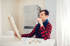 Young man artist painting at home creative painting stock illustration