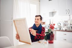 Young man artist painting at home creative painting.  stock illustration