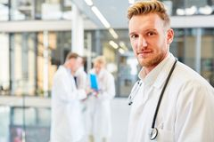 Young man as a competent medical assistant. Young men as a competent medical assistant or medicine student in the hospital royalty free stock image