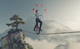 Young man as juggler. Juggler is balancing on rope with a bike between two mountains. This is a 3d render illustration Royalty Free Stock Photos