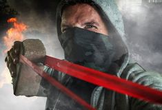 Free Young Man As Ultra And Radical Anarchist Rioter . Furious Antifa Protester In Face Mask Throwing Brick Hostile On Street On Royalty Free Stock Photos - 161694988