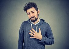 Young man felling bad of guilt Royalty Free Stock Images