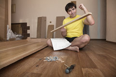 Young man assembling furniture Royalty Free Stock Photo