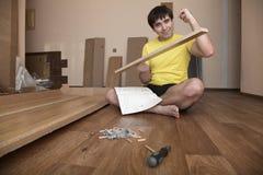 Young man assembling furniture Royalty Free Stock Photo