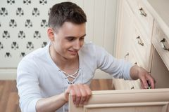 Young man assembling furniture Stock Image