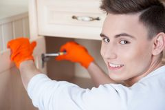 Young man assembling furniture Royalty Free Stock Images