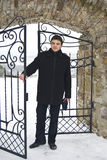 Young Man At A Welded Gate Royalty Free Stock Photos