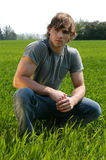 Young Man At The Green Grass Stock Image