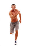 Young man athlete doing running exercise Stock Images