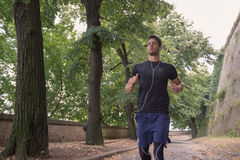 Young man athlete jogger runner close up outdoors.  stock image