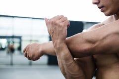 Man athlete prepare for training in gym. bodybuilder male warm u Stock Images