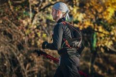 Young man athlete running marathon walking sticks Royalty Free Stock Photo