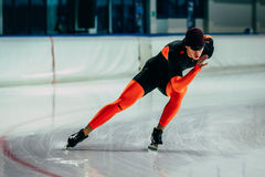 Young man athlete skater warming up before race sprint distance Royalty Free Stock Images