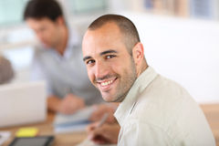 Young man attending business class Stock Photos