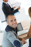 Young man attending business presentation Royalty Free Stock Image