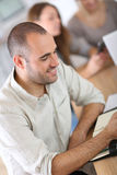 Young man attending meeting at school Royalty Free Stock Photography