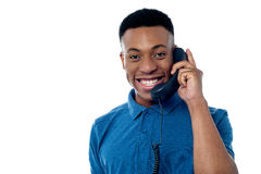 Young man attending phone call Stock Images
