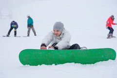 Young man attending to his snowboard Stock Photo