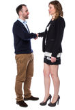 Young man and an attractive woman shaking hands Stock Photo