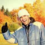 Young Man in the Autumn Park Royalty Free Stock Photo