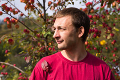 Young man in autumn Stock Images