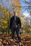 Young Man in autumnal park Royalty Free Stock Images