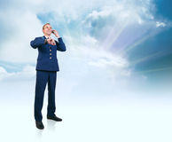 Young man in aviation uniform  over blue sky background Royalty Free Stock Photography