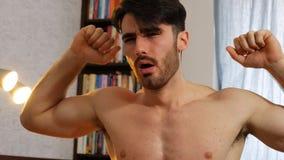 Young man awakening at home Stock Photography