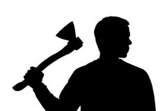 Young man with an ax in his hand - silhouette Stock Photo