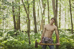 Young man with axe Royalty Free Stock Photo