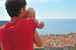 Young man with a baby looking at Dubrovnik stock image