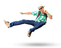 Young man with back pack sky kick jumping action isolated white Royalty Free Stock Photography