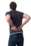 Young Man with back pain. Young man holding his back in pain Royalty Free Stock Photography