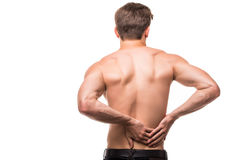 Young man with back pain in back on white background. Young man with back pain in back Stock Photography
