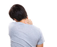 Young man with back pain. Isolated on white Royalty Free Stock Image