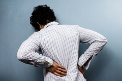 Young man with back pain Stock Image