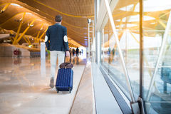 Man back walking at the airport Stock Photography