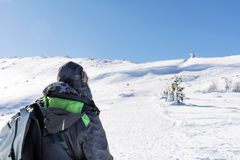 Hiker Man in the Winter Mountain. Young man in back in the  winter mountain , adventure concept Stock Photo