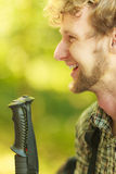 Young man with backpack hiking in forest trail Stock Image