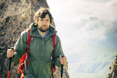 Young Man with backpack hiking outdoor Travel Royalty Free Stock Image
