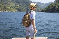 Young man with backpack and map. People travel and vacation Royalty Free Stock Photos