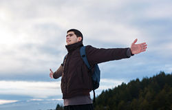 Young man with backpack in mountain Royalty Free Stock Photography