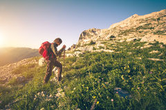 Young Man with backpack mountaineering outdoor Royalty Free Stock Images