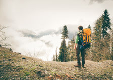 Young Man with backpack relaxing outdoor Stock Image